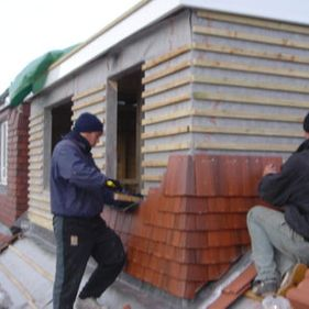 Roofers working on a roof installation
