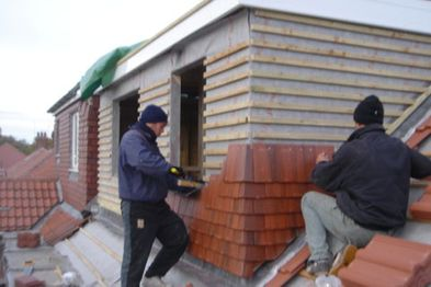 Roofers working on a roof conversion
