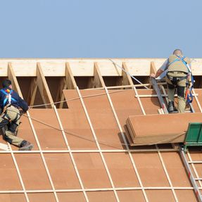 Roofers installing a new roof
