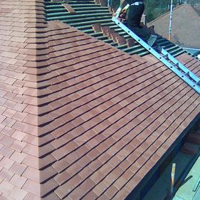 Tiles being fitted on roof