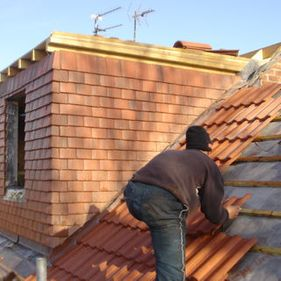 Roofer installing roof tiles